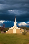 Church and steeple with stormy sky in Phillipsburg, Montana