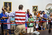 Guests at the American Presidential Experience exhibit learn about the Oval Office from a guide on Sunday, September 2, 2012 in Charlotte, NC.