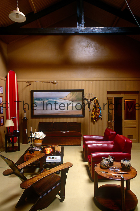 In the living room a sense of spaciousness is conveyed by the high beamed ceiling