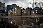 Southend United 1 Burton Albion 1, 22/02/2016. Roots Hall, League One. The ticket office building and its reflection at Roots Hall stadium, pictured before Southend United took on Burton Albion in a League 1 fixture. Founded in 1906, Southend United moved into their current ground in 1955, the construction of which was funded by the club's supporters. Southend won this match by 3-1, watched by a crowd of 6503. Photo by Colin McPherson.