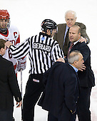 Joe Pereira (BU - 6), Albie O'Connell (Northeastern - Assistant Coach), Bob Bernard, Jack Parker (BU - Head Coach), Greg Cronin (Northeastern - Head Coach), Mike Geragosian (BU - Assistant Coach) - The visiting Northeastern University Huskies defeated the Boston University Terriers 5-4 on Sunday, March 13, 2011, to win their Hockey East Quarterfinal matchup 2 games to 1 at Agganis Arena in Boston, Massachusetts.