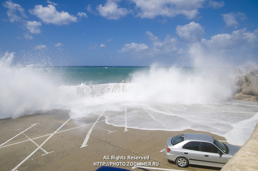 Rethymno Crete parking lot with stormy waves