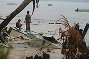 Children of Betio village play on top of up-turned boats in the strong surf caused by the king tides which hit on the coast of the Pacific island of Kiribati. The high tides caused damage to homes and crops.The islands, and their way of life, are endangered by rising sea water levels which are eroding the fragile atoll, home to approximately 92,000 people.