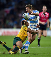 Santiago Cordero of Argentina offloads the ball after being tackled by Will Genia of Australia. Rugby World Cup Semi Final between Argentina v Australia on October 25, 2015 at Twickenham Stadium in London, England. Photo by: Patrick Khachfe / Onside Images