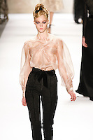 Theres Alexandersson walks runway in a Monique Lhuillier Fall 2011 outfit, during Mercedes-Benz Fashion Week Fall 2011.