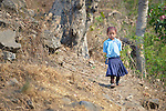 A girl walks to school in the morning in the village of Tanglichowk in the Gorkha District of Nepal that was hard hit by a 2015 earthquake.