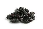 Black raisin close-up Isolated on white background