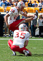 New Mexico kicker Justus Adams (98) and holder Ben Skaer (35). The Pitt Panthers defeated the New Mexico Lobos 49-27 on Saturday, September 14, 2013 at Heinz Field, Pittsburgh, Pennsylvania.