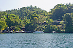 Guest lodgings rise on the surrounding hills, while the dive shop, restaurant, pool, and common areas surround the mooring int he center of the Lembeh Resort, on Lembeh Island, off North Sulawesi, Indonesia.