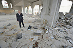 Father Emanuel Youkhana ponders the rubble of a Syriac Orthodox Church in Mosul, Iraq, on January 27, 2017. According to neighbors, the Islamic State group--which took over the city in 2014--used the building as a warehouse until the final weeks of their occupation, when they awarded the building to a contractor who began to demolish it in order to salvage the steel rebar in the walls. Although this portion of the city was liberated in early 2017, Christians are unlikely to return soon due to concerns about their security in the Sunni community.<br /> <br /> Youkhana is a priest in Duhok of the Holy Apostolic Catholic Assyrian Church of the East.