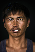35 year old Tuna fisherman, Pepe Pilapil poses for a portrait at the Casa, the Tuna buying house in Puerto Princesa, Palawan in the Philippines. <br /> Photo: Sanjit Das/Panos for Greenpeace