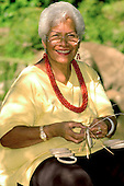 A Kapuna, elder or senior making lauhala woven bracelets