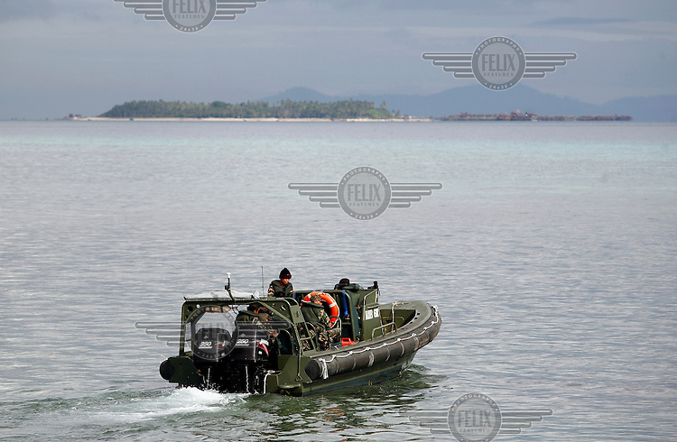 A Malaysian military patrol boat in the waters near popular diving destination Sipadan. The proximity to Philipine waters and rebel groups there has made the authorities put troops on or near tourist destinations.