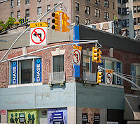 """New traffic restrictions at Broadway and West 96th Street in New York on Monday, August 4, 2014. As part of Mayor Bill de Blasio's """"Vision Zero"""" initiative the speed limit of 30 mph has been reduced to 25 mph. Broadway from West 59th Street to West 220 Street has been posted as a """"Slow Zone"""". with the other """"Slow Zone"""" starting today atSouthern Blvd. in the Bronx. Two dozen zones will be instituted in the five boroughs over the course of several months. 22 pedestrians have been killed since 2008 in the Broadway """"Slow Zone"""" and speeding is the top cause of traffic injuries and fatalities.   (© Richard B. Levine)"""