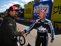 Aug 21, 2016; Brainerd, MN, USA; NHRA top alcohol dragster driver Joey Severance (left) is congratulated by Duane Shields after winning the Lucas Oil Nationals at Brainerd International Raceway. Mandatory Credit: Mark J. Rebilas-USA TODAY Sports