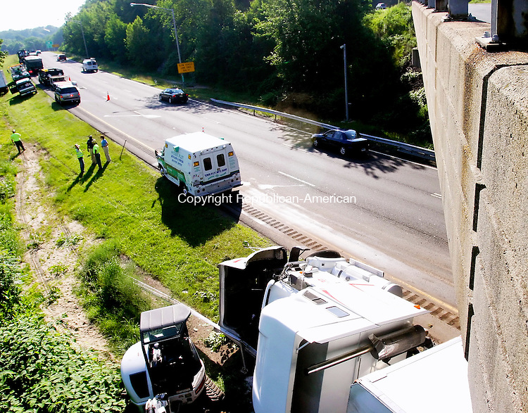 MIDDLEBURY CT. 30  June 2008-063008SV02--A tractor trailer driver fell asleep and rolled his truck over under a bridge on I84 east at exit 17 in Middlebury early Monday morning.<br /> Steven Valenti Republican-American