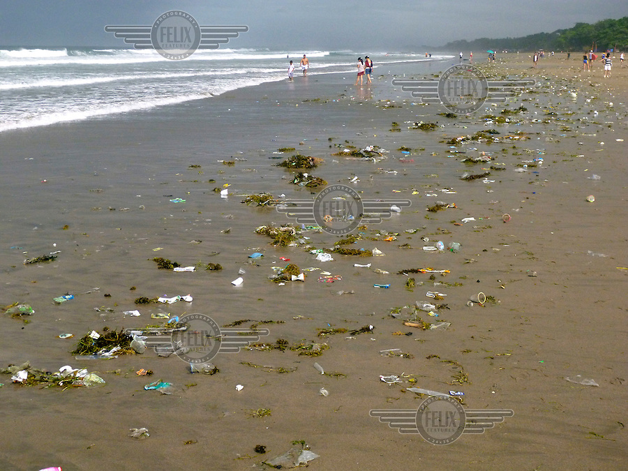 Tourists walking the Legian beach encounter vast amounts of plastic and other garbage, just North of the famous Kuta beach on Bali. Enormous amounts of litter wash up every day, especially in the rainy season.