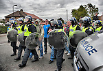 LONDON, ENGLAND - SEPTEMBER 11: Police officers move to contain protestors during clashes in front of Harrow Central Mosque on September 11, 2009 in London, England. Anti-fascist demonstrators and local muslim youths gathered to counter a threatened march by rightwing groups....***Standard Licence  Fee's Apply To All Image Use***.Marco Secchi /Xianpix. tel +44 (0) 845 050 6211. e-mail ms@msecchi.com or sales@xianpix.com.www.marcosecchi.com
