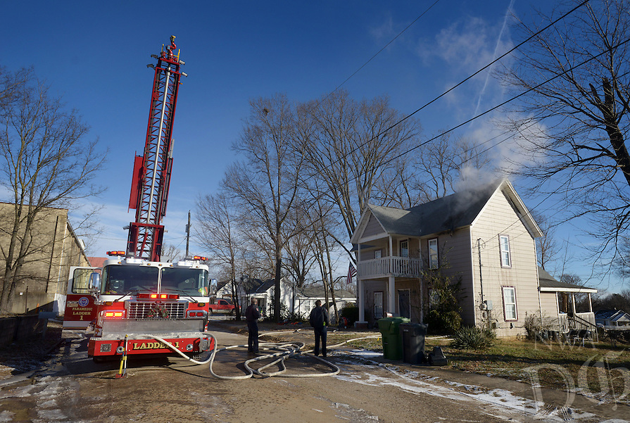 NWA Democrat-Gazette/BEN GOFF @NWABENGOFF<br /> Rogers firefighters work a house fire on Monday Dec. 19, 2016 at 623 South 1st Street in Rogers. One person was home at the time of the fire in the attic and no one was injured, according to Rogers Fire Chief Tom Jenkins.