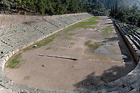 DELPHI, GREECE - APRIL 11 : A panoramic view of the Stadium from the west side with the three apsed entrance in the distance, on April 11, 2007, in the Sanctuary of Apollo, Delphi, Greece. The Stadium was built in the 5th century BC and remodeled in the 2nd century AD when Herodus Atticus ordered the stone seating and the arched entrance. (Photo by Manuel Cohen)