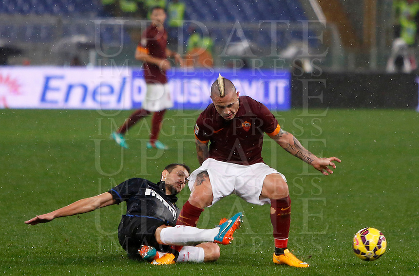 Calcio, Serie A: Roma vs Inter. Roma, stadio Olimpico, 30 novembre 2014.<br /> Roma&rsquo;s Radja Nainggolan is tackled by FC Inter&rsquo;s Zdravko Kuzmanovic, left, during the Italian Serie A football match between AS Roma and FC Inter at Rome's Olympic stadium, 30 November 2014.<br /> UPDATE IMAGES PRESS/Riccardo De Luca
