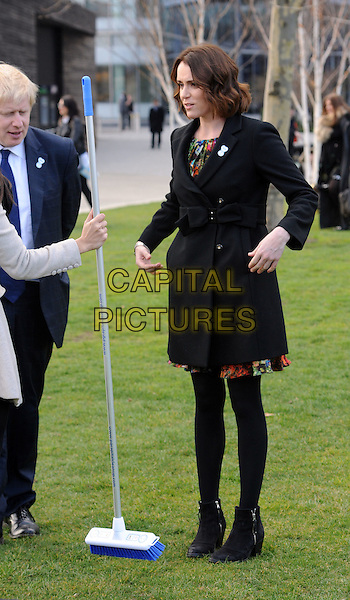 Mayor Boris Johnson & Keeley Hawes .The P&G Capital Clean Up launch campaign photocall, Potters Field Park, London, England..March 8th, 2012.full length black jacket suit blue tights coat bow ankle boots  broom MP .CAP/WIZ.© Wizard/Capital Pictures.
