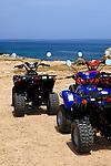 Three ATVs on a sea shore. Cape Gkreko, Cyprus, the Mediterranean sea.
