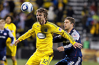 8 MAY 2010:Eddie Gaven of the Columbus Crew (12) and New England Revolutions' Chris Tierney (8) during MLS soccer game between New England Revolution vs Columbus Crew at Crew Stadium in Columbus, Ohio on May 8, 2010. The Columbus defeated New England 3-2.
