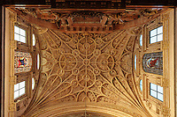 Elaborately carved ceiling above the Capilla Mayor, or chancel, built 1523, in front of the huge 18th century neoclassical altarpiece by Alonso Matias with 5 paintings by Antonio Palomino and sculptures by Pedro de Paz, in the in the 16th century cathedral within the Cathedral-Great Mosque of Cordoba, in Cordoba, Andalusia, Southern Spain. The first church built here by the Visigoths in the 7th century was split in half by the Moors, becoming half church, half mosque. In 784, the Great Mosque of Cordoba was begun in its place and developed over 200 years, but in 1236 it was converted into a catholic church, with a Renaissance cathedral nave built in the 16th century. The historic centre of Cordoba is listed as a UNESCO World Heritage Site. Picture by Manuel Cohen