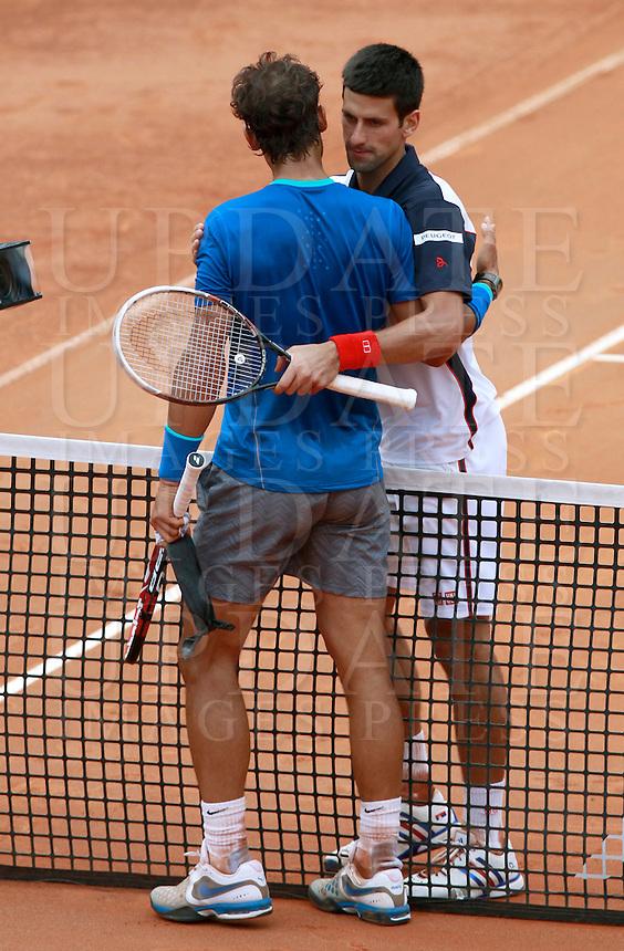 Il serbo Novak Djokovic saluta lo spagnolo Rafael Nadal, a sinistra, dopo averlo sconfitto nella finale maschile degli Internazionali d'Italia di tennis a Roma, 18 maggio 2014.<br /> Serbia's Novak Djokovic comforts Spain's Rafael Nadal, left, after beating him in the men's final match of the Italian open tennis tournament, in Rome, 18 May 2014.<br /> UPDATE IMAGES PRESS/Isabella Bonotto