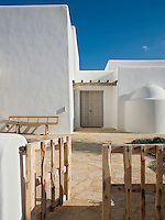 The simple lines and organic shapes of the whitewashed exterior of the restored Ibizan farmhouse