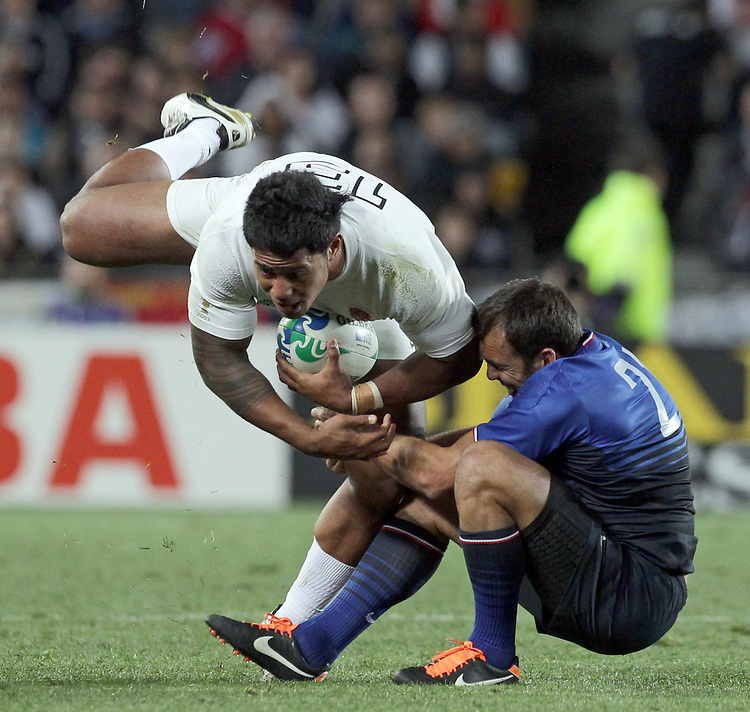 England's Manu Tuilagi is tackled by France's David Marty during quarter-final 2 match of the Rugby World Cup 2011, Eden Park, Auckland, New Zealand, Saturday, October 08, 2011.  Credit:SNPA / David Rowland