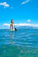 Young woman standup paddle boarding, Makena, southwest Maui