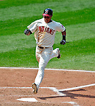 6 September 2009: Cleveland Indians' outfielder Michael Brantley crosses the plate to score on a Jhonny Peralta single against the Minnesota Twins at Progressive Field in Cleveland, Ohio. The Indians defeated the Twins 3-1 to take the rubber match of their three-game weekend series. Mandatory Credit: Ed Wolfstein Photo