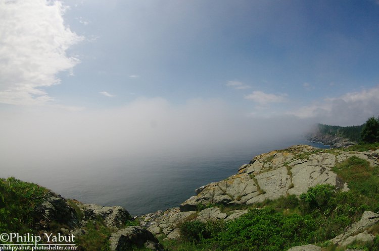 Remnants of a heavy fog hug the cliffs of Whitehead at Monhegan Island.