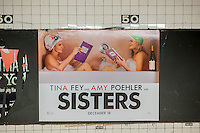 "A poster for the Tina Fey, Amy Poehler film ""Sisters"" in the New York subway on Thursday, December 10, 2015. The studios of both ""Sisters and ""Alvin and the Chipmunks: The Road Chip"" have decided to open their films on December 18, the same day as ""Star Wars: The Force Awakens"" opens. Both movies appeal to different demographics with ""Alvin"" going for kids on break and ""Sisters"" appealing to the girls-night-out crowd. (© Richard B. Levine)"