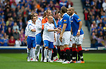 Rangers v St Johnstone....28.08.10  .Jdoy Morris leads the teams before kick off.Picture by Graeme Hart..Copyright Perthshire Picture Agency.Tel: 01738 623350  Mobile: 07990 594431