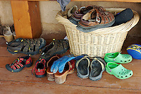 Shoe basket of Tias and Surya Little and their son, Eno