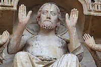 Christ, the sovereign judge, holding up his hands to show his stigmata, with the Virgin and St John, from the second level of the Tympanum of the central portal, known as the Beau-Dieu portal, dedicated to the Last Judgment, on the Western facade of the Basilique Cathedrale Notre-Dame d'Amiens or Cathedral Basilica of Our Lady of Amiens, built 1220-70 in Gothic style, Amiens, Picardy, France. Amiens Cathedral was listed as a UNESCO World Heritage Site in 1981. Picture by Manuel Cohen