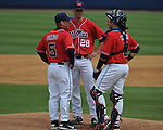 Ole Miss Mike Mayers (28), with head coach Mike Bianco (5) and catcher Austin Knight (3) pitches vs. Houston at Oxford-University Stadium in Oxford, Miss. on Sunday, March 11, 2012. Ole Miss won 11-3 to sweep the three-game series. Mayers got the win.