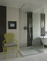 The main feature of the contemporary bathroom is a walk-in glass shower cabinet