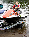 SOUTHBURY CT. 04 July 2015-070415SV04-Tyler Setlefsen, 16, of Southbury rides his jet ski onto the water while launching at the Lake Zoar boat launch in Southbury Saturday.<br /> Steven Valenti Republican-American