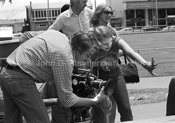 "Actress Jodie Foster, age 14, goes behind the camera while on location shooting ""Americans,"" a documentary by Desmond Wilcox. Los Angeles, June, 1977. Photo by John G. Zimmerman"