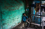 A young boy drinks tea at a tea stall next to the open cast mine, Ghanudih in Jharia, outside of Dhanbad in Jharkhand, India.  Photo: Sanjit Das/Panos