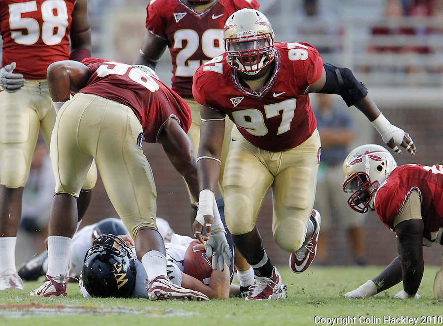 TALLAHASSEE, FL 9/25/10-FSU-WF FB10 CH-Florida State's Demonte McAllister celebrates sacking Wake Forest's Ted Stachitas during second half action Saturday at Doak Campbell Stadium in Tallahassee. The Seminoles beat the Demon Deacons 31-0..COLIN HACKLEY PHOTO