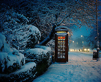 """A snow covered phone box in Highgate, North London where 28 year old Hamid from Iran used to shelter in the years he spent living on the streets. """"When you're sleeping outside one night feels like one year because it's so cold. I never managed to sleep for more than an hour or two and when it's raining it's hard to sleep for more than fifteen minutes at a time."""" Hamid is one of an estimated 300,000 rejected asylum seekers living in the UK."""