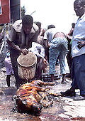 A large cooked pig is washed off on the streets of Citi Soleil, Haiti. photo by jane therese