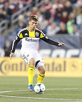 Columbus Crew midfielder Wil Trapp (20) at midfield.  In a Major League Soccer (MLS) match, the New England Revolution (blue) defeated Columbus Crew (white), 3-2, at Gillette Stadium on October 19, 2013.