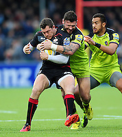 Alex Goode of Saracens is tackled by Adam Thompstone of Leicester Tigers. Aviva Premiership match, between Saracens and Leicester Tigers on October 29, 2016 at Allianz Park in London, England. Photo by: Patrick Khachfe / JMP