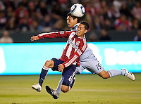 Sporting Kansas City defender Roger Espinoza (15) and Francisco Mendoza (6) battle. Sporting KC defeated CD Chivas USA 3-2 at Home Depot Center stadium in Carson, California on Saturday March 19, 2011...
